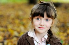 Portrait Of Adorable Child Girl In Autumn Forest Royalty Free Stock Photos