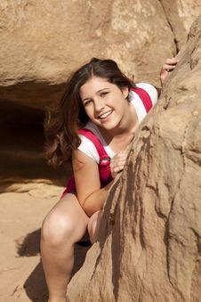 Free Girl Behind Rock Stock Image - 21239721