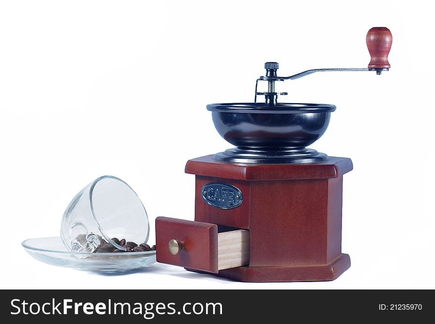 Coffee  grinder  and a glass cup