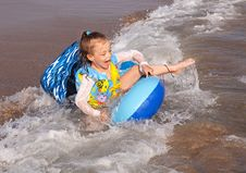 Free Child Rides A Wave Of The Sea. Stock Image - 21242551