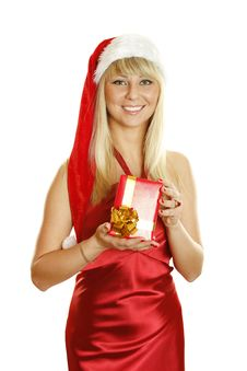 Young Woman Dressed As Santa With A Gift. Royalty Free Stock Photo
