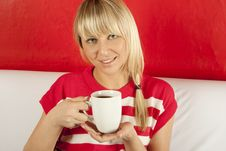 Attractive Young Woman Drinking Coffee At Home Stock Photos