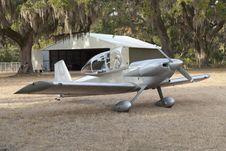 Beautiful Silver Plane By Hangar Stock Photo