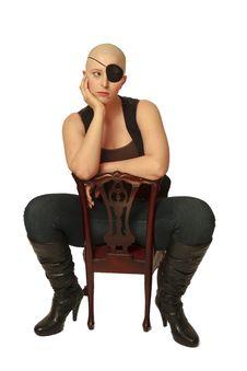 Free Sad Bald Girl On Chair Stock Photography - 21248102