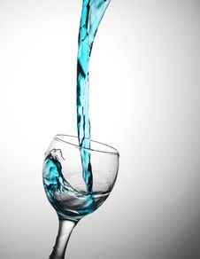 Free Blue Water Flows In A Glas Royalty Free Stock Images - 21250349