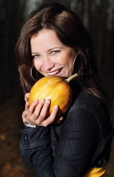 Smiling Girl With Pumpkin Royalty Free Stock Images