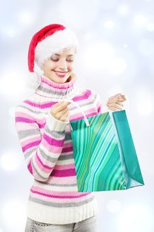 Free Santa Girl Holding Shopping Bag Royalty Free Stock Photos - 21252808