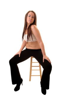 Girl Sitting On Chair. Stock Photo