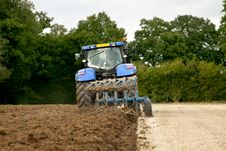 Free Tractor Ploughing Rear View Stock Photos - 21255343