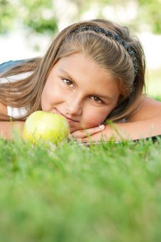 Little Girl With Apple Stock Image