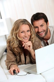 Free Couple Smiling On Laptop. Stock Photos - 21257293