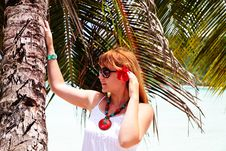 Beautiful Woman Standing Under Palm Tree Stock Images