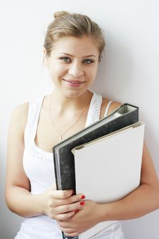 Free Teenage Girl With Books In Her Arms Royalty Free Stock Photography - 21257887