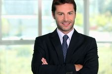 Businessman Standing In Front Of A Window Royalty Free Stock Photography