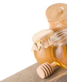 Jar Full Of Honey And Stick Stock Image