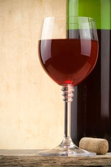 Glass Of Red Wine And Bottle Stock Photography