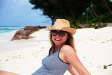 Happy Woman In Cowboy Hat Resting On A Beach