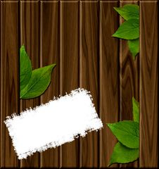 Free Wooden Background With Green Leaves Royalty Free Stock Photos - 21258998