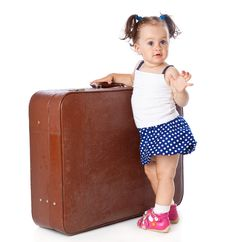 A Little Girl Is Standing Near The Suitcase Stock Photos