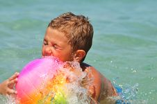 Boy In The Water Playing With A Ball Royalty Free Stock Image