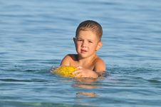 Boy In The Water Playing With A Ball Royalty Free Stock Photos
