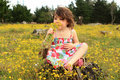 Free Young Girl Smelling Flowers Royalty Free Stock Image - 21260656