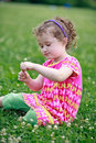 Free Little Girl Is Picking Flowers On Field Royalty Free Stock Images - 21269079