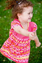 Free Cute Girl Running And Smiling At Camera Royalty Free Stock Image - 21269146