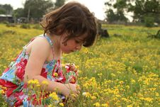 Free Young Girl Walking Through A Meadow Royalty Free Stock Photos - 21260568
