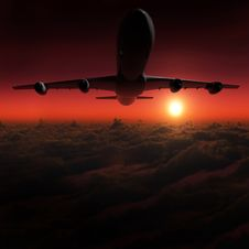 Free Airplane In The Sky At Sunset Royalty Free Stock Photo - 21260985