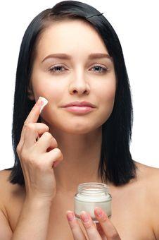 Free Woman Applying Moisturizing Cream Stock Images - 21262354