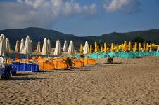 Umbrellas And Deck Chairs On The Sandy Beach Stock Image