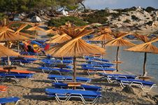 Free Umbrellas And Deck Chairs On The Sandy Beach Royalty Free Stock Photo - 21265635