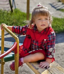 Adorable Little Girl Having Fun On A Swing Stock Photo