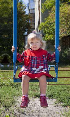 Adorable Little Girl Having Fun On A Swing Stock Image