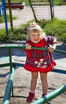 Adorable Little Girl Playing In The Playground Stock Photography