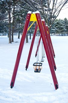 Free Empty Children Swings In A Winter Park Royalty Free Stock Photo - 21266155