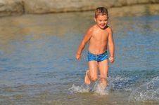 Free Boy Running Down The Beach Royalty Free Stock Photo - 21266955