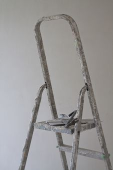 Ladder And Putty Knife Stock Image