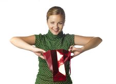 Free Surprised Crafty Young Girl Is Opening Gift Bag Stock Photos - 21268283