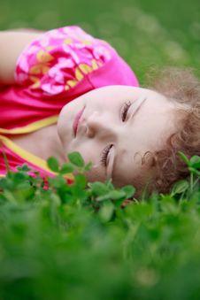 Free Little Adorable Girl Lying On Grass Stock Photos - 21269113