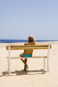 Free Blond Girl Sitting On The Bench Royalty Free Stock Photos - 21269178