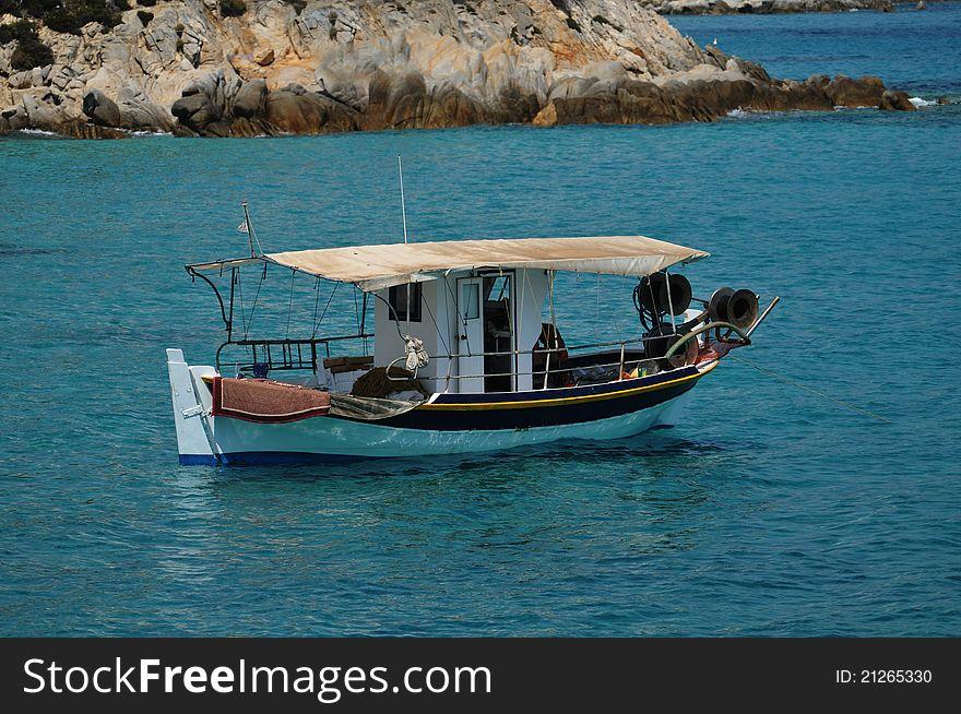 Fishing boat in the beautiful sea bay