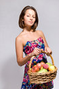 Free Girl Holding Basket Full Of Fruit Royalty Free Stock Photography - 21272287