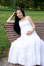 Free Beautiful Pregnant Girl Sitting On Bench Royalty Free Stock Photos - 21274628