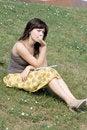 Free Girl Sitting On Grass Royalty Free Stock Image - 21274966