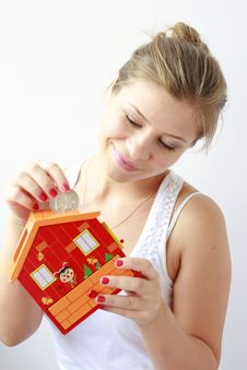 Free Teenage Girl Putting Coins In Her Moneybox Stock Photography - 21271972