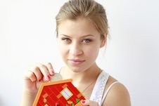 Teenage Girl Putting Coins In Her Moneybox Stock Photo