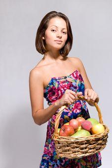 Free Girl Holding Basket Full Of Fruit Royalty Free Stock Photography - 21272287
