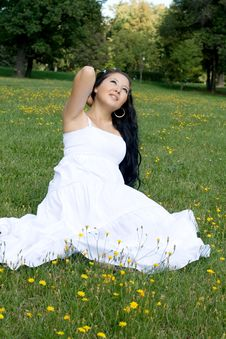 Free Beautiful Pregnant Girl Sitting On Grass Stock Photography - 21274602